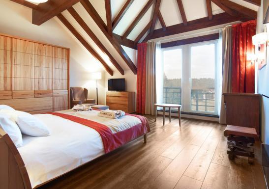 Dormitorul din apartamentul Presidential Suite de la Ana Spot Hotel